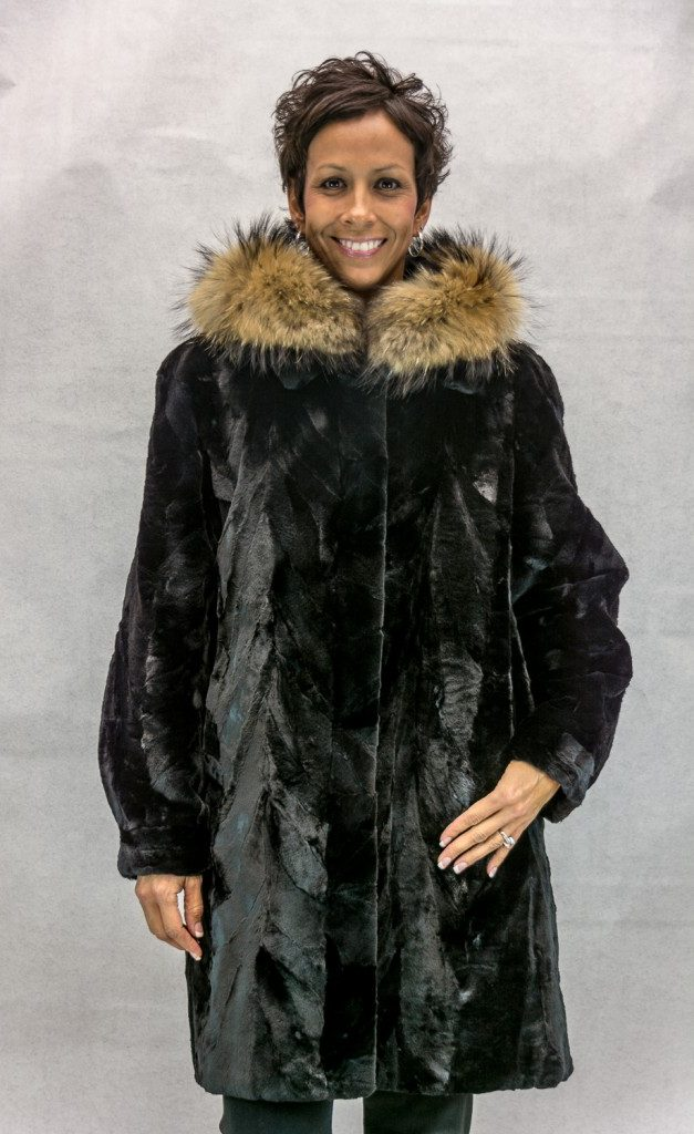 W51 black sheared mink 36 sections with a detachable hood trimmed with finnish raccoon reverses to black taffeta silk2 e1506396682489