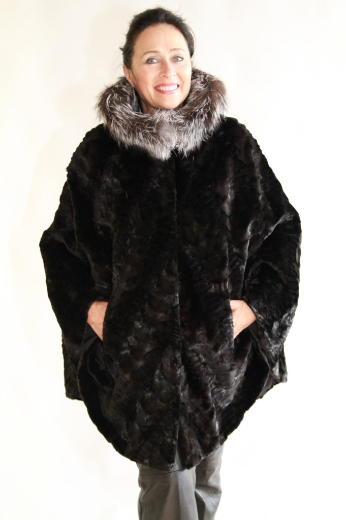 black sheared mink sections 36 chevron design with grooving detail cape parka and indigo fox trim around the hood2